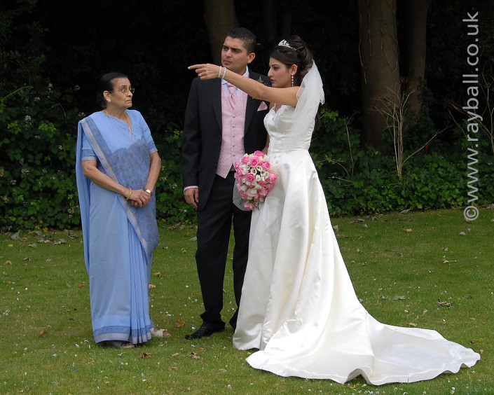 Bride instructing groom, Leatherhead at Register by Epsom Photography Surrey.