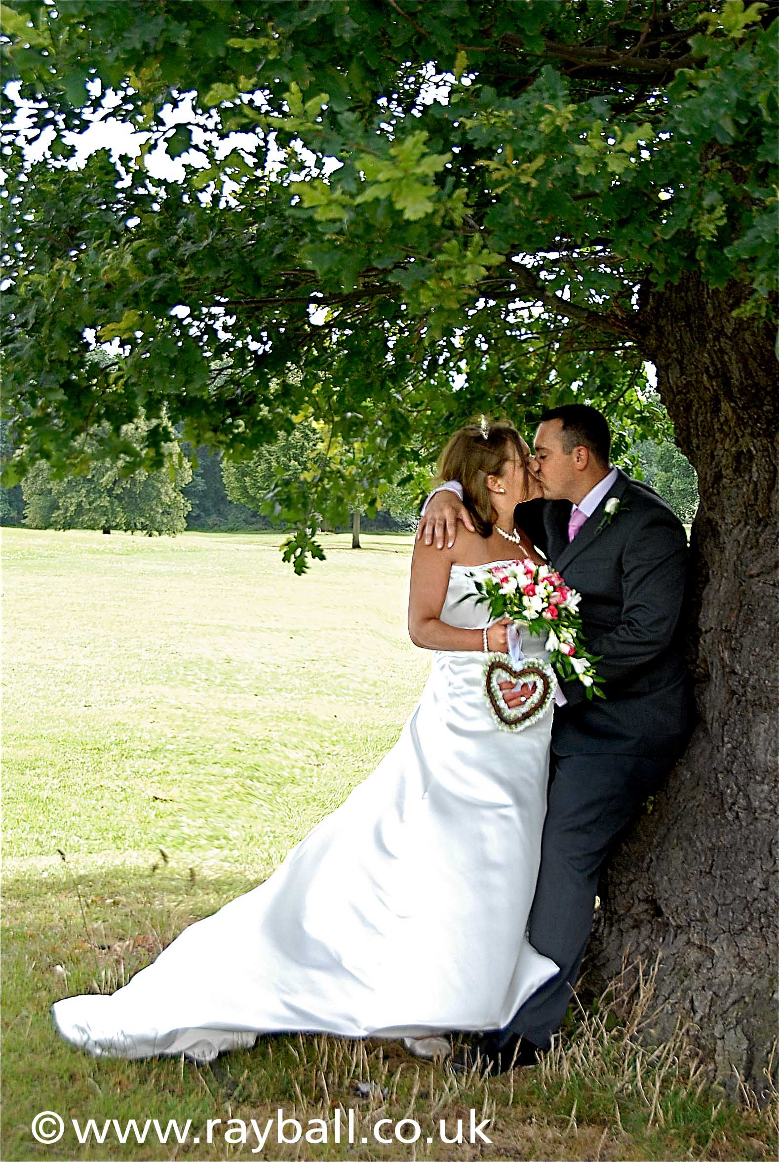 Mitcham couple Just married photographed in Morden Park, London by Epsom Photography Surrey.