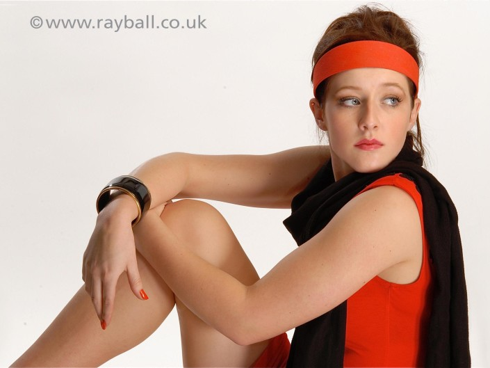 Tadworth model in red and black at Epsom Photography Studioy studio.
