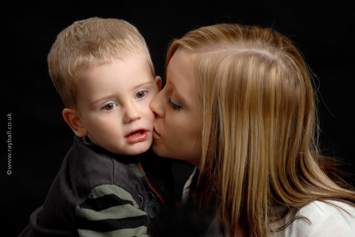 Mother from Ashtead, Surrey, kissing her child - KEL_0034kLR