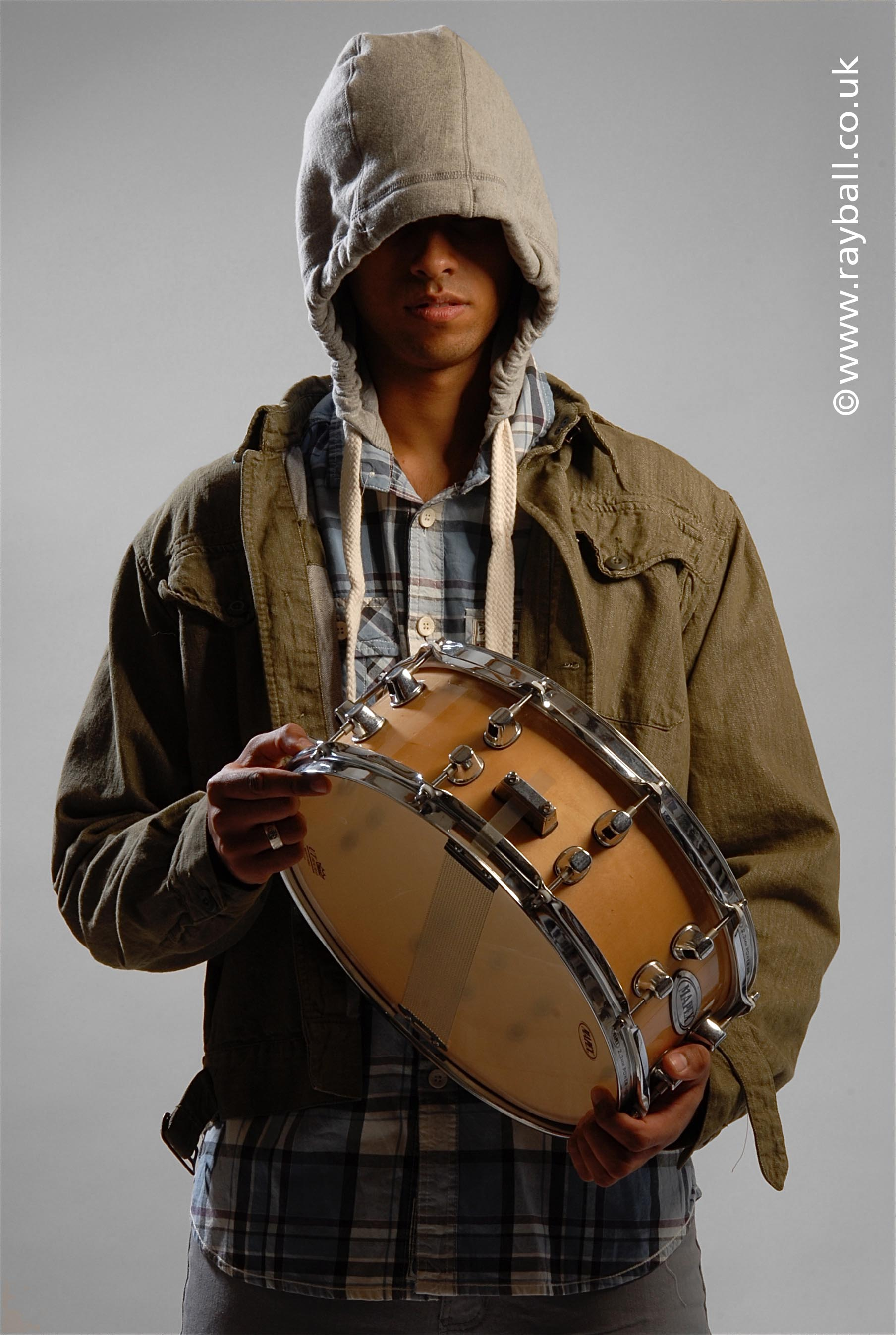 Leatherhead model wearing Tadworth styled clothes with drum at Epsom Photography studio Surrey