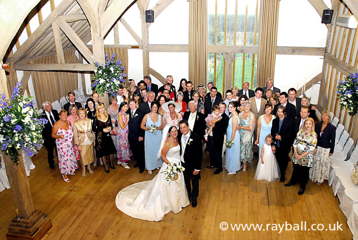Wedding congregation shot from balcony at Betchworth near Reigate at the foot of the North Downs in Surrey.
