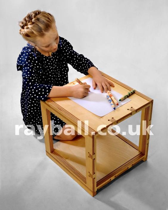 Little girl from Stoneleigh at flat pack desk designed in Horsham at Epsom Photography Studio Surrey.
