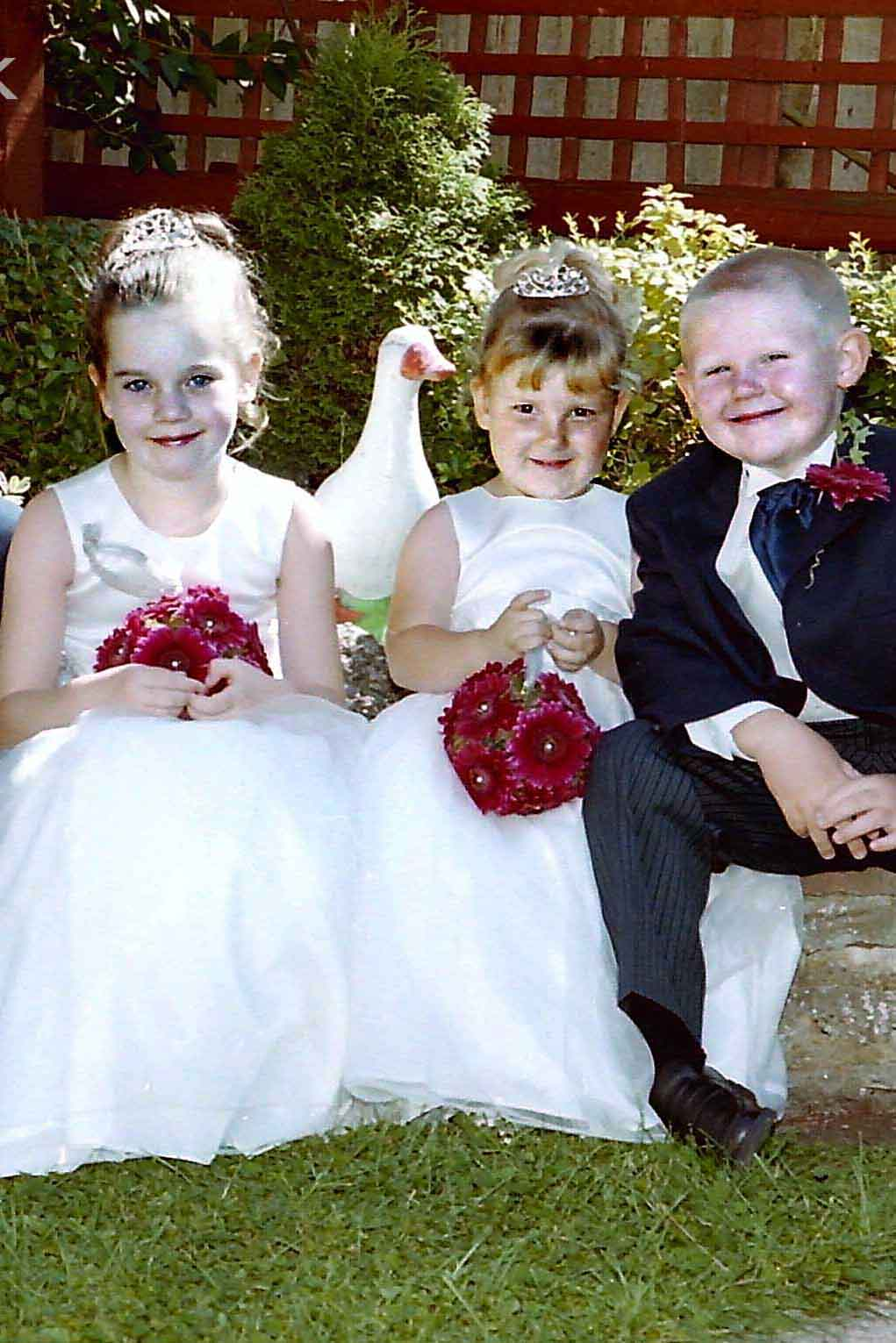 Beautiful picture of bridesmaids, pageboy and goose in Malden Rushett garden Kingston.