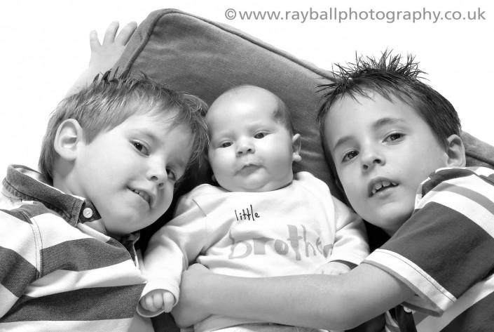 Portrait of Oxshott siblings at Epsom Photography Studio Surrey.