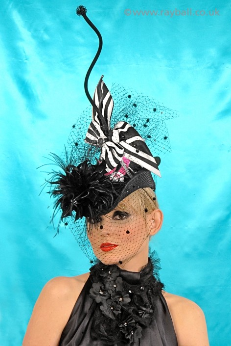 Croydon model wearing top milliners hat.