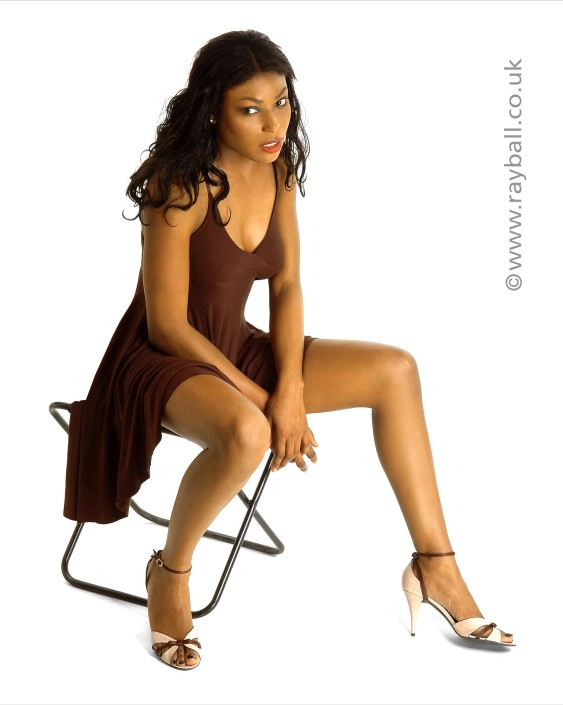 model fro Ewell relaxing in plum at Epsom Photography Studio Surrey.