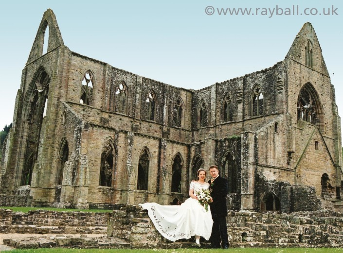 Bride and groom from Farnham at Tintern Abbey, Wales.