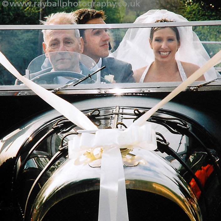 bride and groom in the wedding car Caterham by Epsom Photography Surrey.