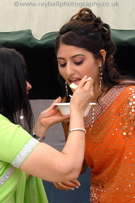 Mother feeding bride at Banstead wedding by Epsom Photography Surrey