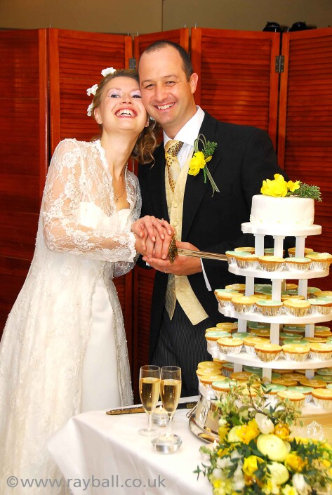 Cheam bride and groom cutting thie wedding cake in Stoke D'Abernon