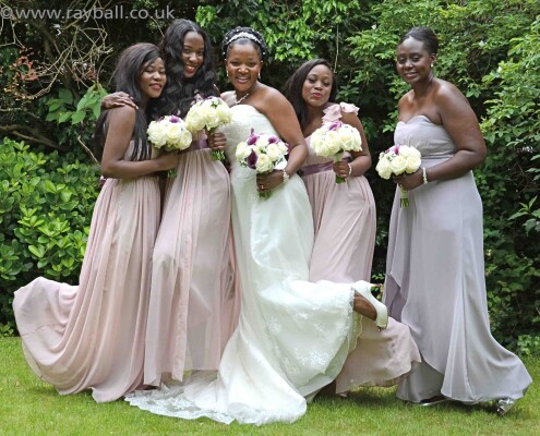Worcester Park bride with bridesmaids at Sutton Registry Office garden