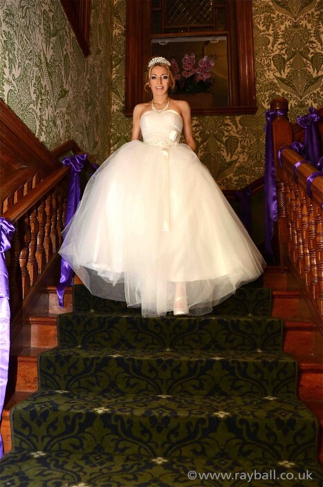 Cheam bride descending stairs at Woodlands Park Hotel, Stoke D'Aberon, Surrey