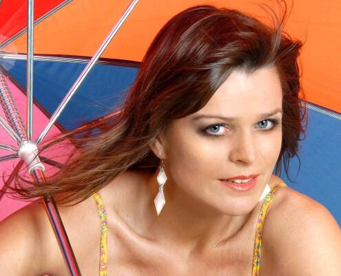 Headley girl under parasol Worcester Park