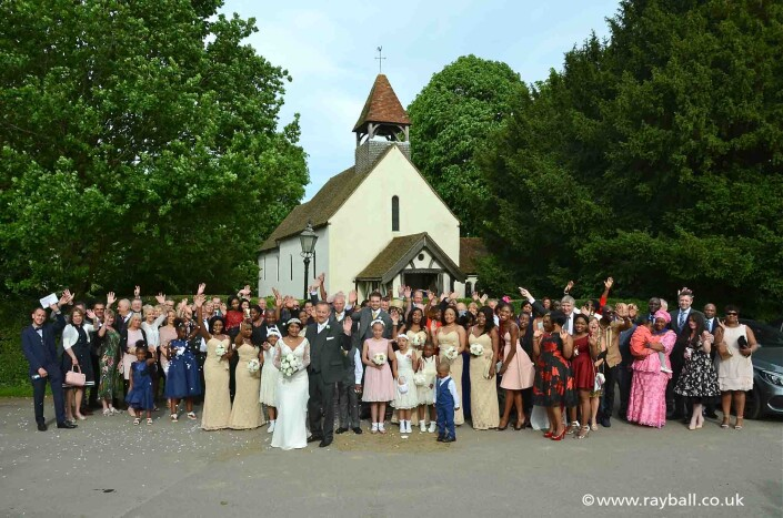 Waiving wedding congregation in front of church in Addington, Croyden