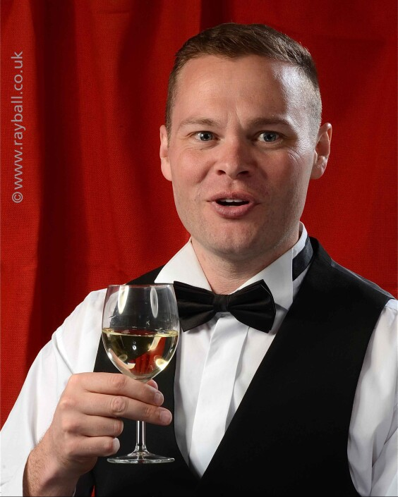 Tolworth guy in tuxedo toasting in Sutton