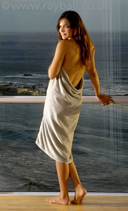 Tolworth model wearing towel in Brighton apartment overlooking the sea.