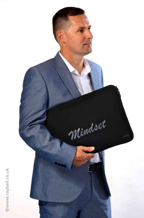 Headly male model carrying Sutton laptop bag.
