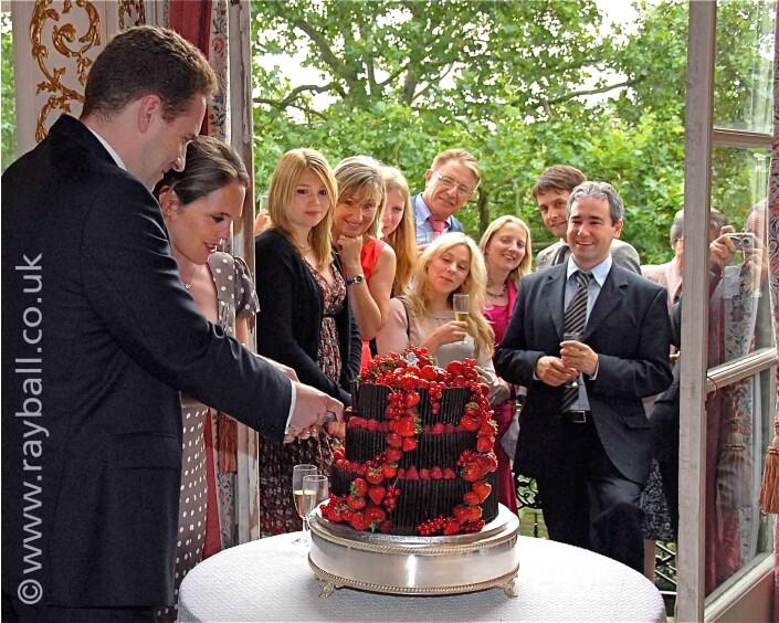 Cake cutting at Stoke D'Abernon wedding celebration