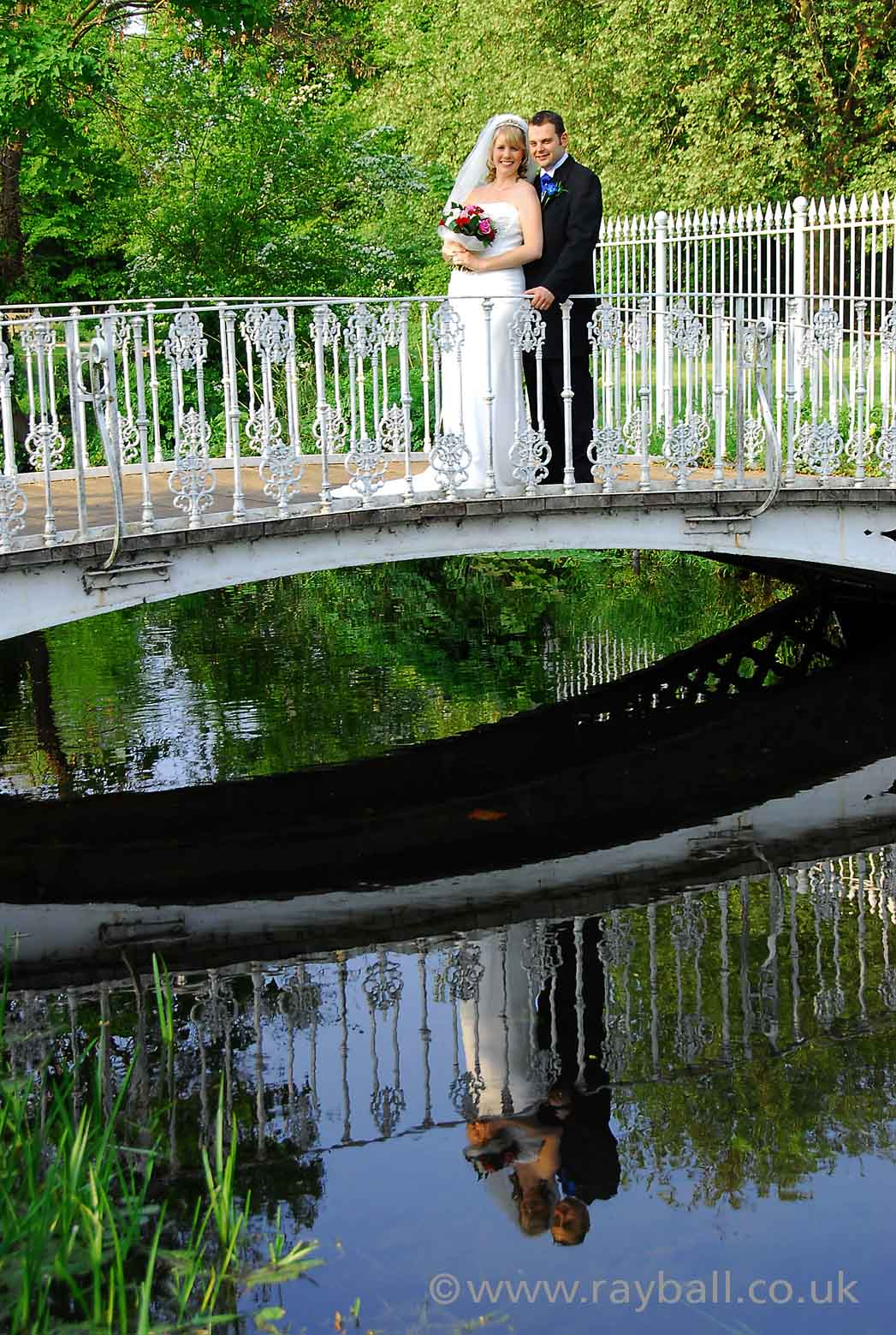 Tolworth bride and groom over river near Sutton.