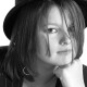 Portfolio shot of pretty Esher model wearing trilby hat.