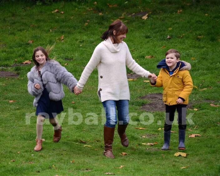 Family at play in Nonsuch Park,Cheam/Ewell,Surrey