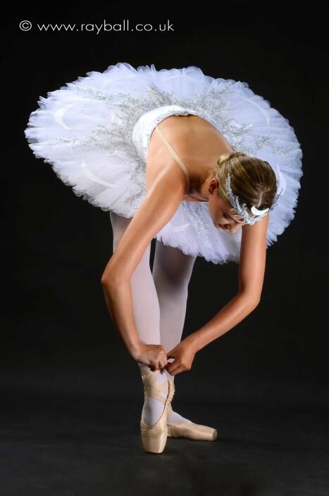 Ballet dancer from Worcester Park fixing her ballet shoe.