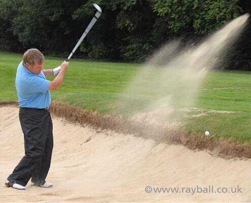 Sutton golfer stuck in bunker Sandown Park Esher Surrey.