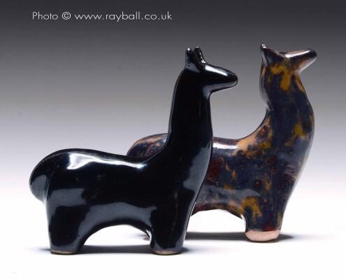 Pair of ceramic llamas from Esher Surrey.
