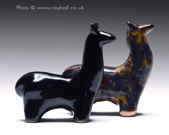Pair of ceramic llamas from Esher Surrey.